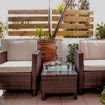 apartment balcony with bamboo armchairs