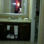 View of bathroom sink area from bedroom door