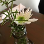 Simple (but real) flowers at each table