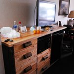TV, microwave and fridge and nice  wood console