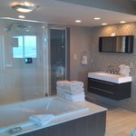 Master bathroom with jetted tub and rainfall glass shower
