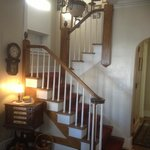 Exquisites antique staircase as you walk in to the foyer