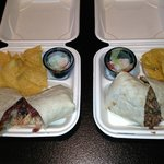 On the left the fried fish burrito $10 on the right the roasted chicken burrito $$9