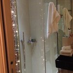lovely bathroom with lights in shower