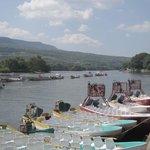 Tourist boats tied up at riverbank