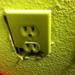 WALL PLUG BY BED.