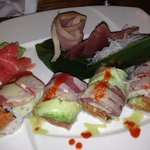 A tuna specialty roll and sashimi