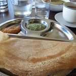 a dosa with two kinds of chutney, and masala tea
