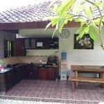 communal ktchen, stove, water dispenser, dishes, fry pan etc