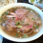 Pho with raw beef, chicken and tendon with rice noodles
