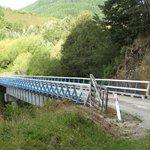 Bridge across the Maruia river leading to the lodge