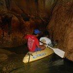 Kayak deep into a mountain cave system.