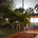 entrance to the Tiki Bar at night with the mist
