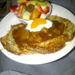 Breakfast- croissant french toast with cinnamon apple topping, sour cream and