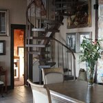 Spiral staircase up to the top floor. Eva's art on the walls of the dining roo