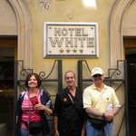 With friends in front of Hotel White