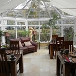 Beautiful sunroom where they service a great breakfast.