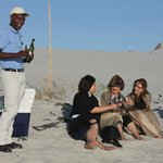 Sundowners on the beach with our friend Nkosana