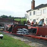 """Working narrow boats outside The """"Nelly"""""""