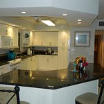 Spacious kitchen with full refrigerator, microwave, stove, dishwasher, double