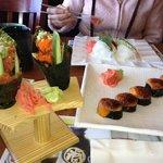 Beautiful spicy tuna hand rolls and volcano roll.