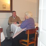Norma and Jim chat over breakfast.