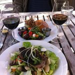 my husband's burger, my rabbit/duck rillette salad with pears ea w/a glass of