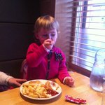 g. enjoying her cod bites and chips while