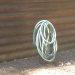 garden hose at back of cabin