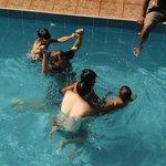 Fun pool, six feet deep. Swim up pool bar stools.