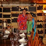 My wife and I in the wine cellar dining area