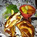 BBQ chicken on pretzel roll