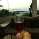 Enjoying a Bellini at Bellini's Bar overlooking the ocean!