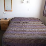 Room with double bed and a single - no air con but opening window