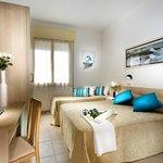 Camera matrimoniale con letto aggiunto