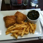Chicken thigh dinner with fries and collard greens
