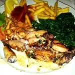 Grilled squids with french fries, and spinach