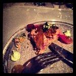 Terrine of foie gras with pork and crispy chicken skin. wonderful red onions w