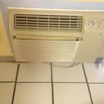 Air conditioner and tile