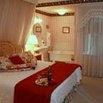 The charming Savannah Room is the original master bedroom of the house.