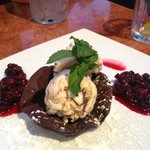 Dessert - berry compote and ice cream with meringue and honeycomb on chocolate