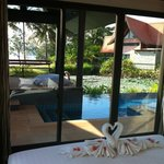 A view out of the bedroom suite to the private pool & sala