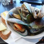 Yummy steamed mussels in white wine and herbs