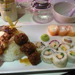 A plate of sushi with skewers