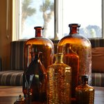 "Charming touches like this collection of ""found"" bottles on"