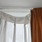 Net curtains not attached to rail