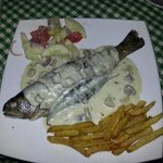Grilled trout with cheese and mushroom.