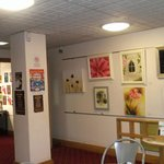Display of local artwork for sale in the Coffee Shop