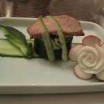 beef on hollowed cucumber filled with salad and radish rose