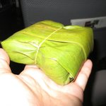 Boxed breakfast sandwich wrapped in banana leaf